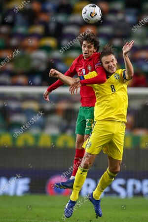 Stock Photo of Portugal national team player Joao Felix (L) in action against Sweden national team player Albin Ekdal during the UEFA Nations League group C soccer match between Portugal and Sweden, held at Alvalade stadium in Lisbon, Portugal, 14 October 2020.