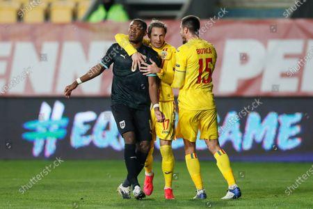 David Alaba of Austria (L) and Ciprian Deac of Romania (R) react during the UEFA Nations League, League B, group 1 match, between Romania and Austria in Ploiesti, Romania, 14 October 2020.