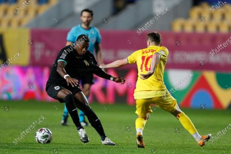 David Alaba of Austria (L) and Alexandru Maxim of Romania (R) in action during the UEFA Nations League, League B, group 1 match, between Romania and Austria in Ploiesti, Romania, 14 October 2020.