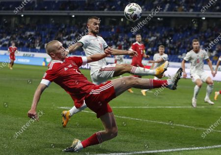 Igor Smolnikov (front) of Russia in action against Filip Holender (C) of Hungary during the UEFA Nations League soccer match between Russia and Hungary in Moscow, Russia, 14 October 2020.
