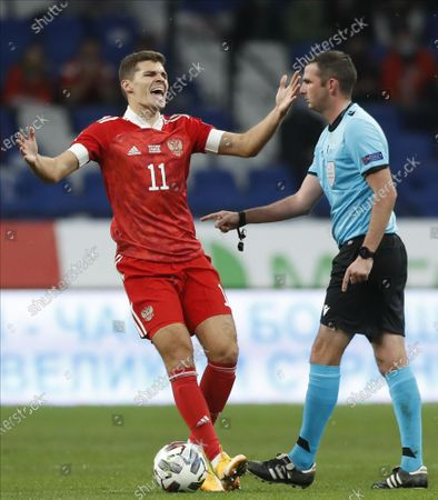 Roman Zobnin (L) of Russia reacts during the UEFA Nations League soccer match between Russia and Hungary in Moscow, Russia, 14 October 2020.