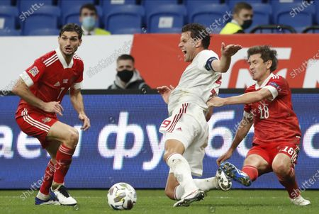 Yuri Zhirkov (R) of Russia in action against Adam Szalai (C) of Hungary during the UEFA Nations League soccer match between Russia and Hungary in Moscow, Russia, 14 October 2020.
