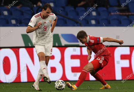 Roman Zobnin (R) of Russia in action against Adam Szalai (L) of Hungary during the UEFA Nations League soccer match between Russia and Hungary in Moscow, Russia, 14 October 2020.