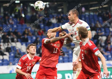 Nemanja Nikolic (2-R) of Hungary in action against Russian players Andrei Semenov (R), Fedor Kudryashov (2-L), and Yuri Zhirkov (L) during the UEFA Nations League soccer match between Russia and Hungary in Moscow, Russia, 14 October 2020.