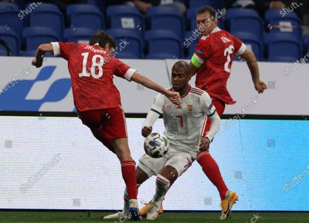 Yuri Zhirkov (L) of Russia in action against Loic Nego (C) of Hungary during the UEFA Nations League soccer match between Russia and Hungary in Moscow, Russia, 14 October 2020.