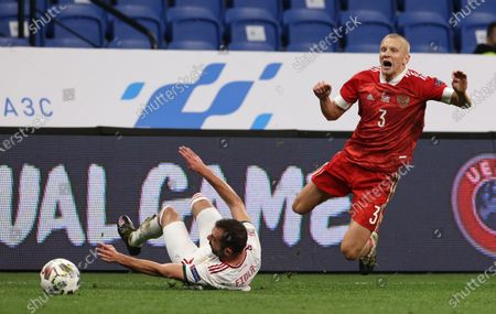Igor Smolnikov (R) of Russia in action against Attila Fiola (L) of Hungary during the UEFA Nations League soccer match between Russia and Hungary in Moscow, Russia, 14 October 2020.