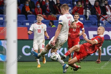 Igor Smolnikov (R) of Russia in action against Attila Szalai (C) of Hungary during the UEFA Nations League soccer match between Russia and Hungary in Moscow, Russia, 14 October 2020.