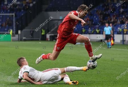 Yuri Zhirkov (up) of Russia in action against David Siger (bottom) of Hungary during the UEFA Nations League soccer match between Russia and Hungary in Moscow, Russia, 14 October 2020.