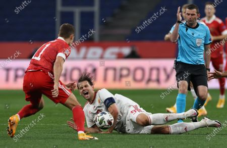Roman Zobnin (L) of Russia in action against Adam Szalai (C) of Hungary during the UEFA Nations League soccer match between Russia and Hungary in Moscow, Russia, 14 October 2020.