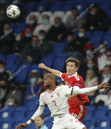 Yuri Zhirkov (R) of Russia in action against Loic Nego (L) of Hungary during the UEFA Nations League soccer match between Russia and Hungary in Moscow, Russia, 14 October 2020.