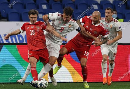 Russian players Yuri Zhirkov (L) and Fedor Kudryashov (2-R) in action against Hungarian players Adam Szalai (2-L) and Daniel Gazdag (R) during the UEFA Nations League soccer match between Russia and Hungary in Moscow, Russia, 14 October 2020.