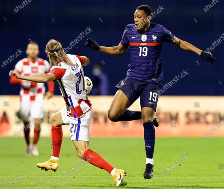 Croatia's Domagoj Vida (L) in action against France's Anthony Martial (R) during the UEFA Nations League soccer match between Croatia and France in Zagreb, Croatia, 14 October 2020.