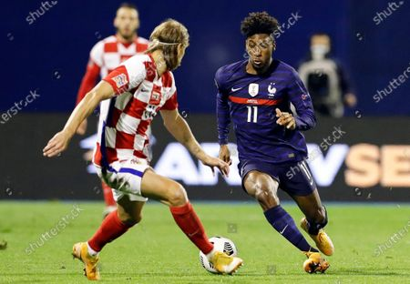 Croatia's Domagoj Vida (L) in action against France's Kingsley Coman (R) during the UEFA Nations League soccer match between Croatia and France in Zagreb, Croatia, 14 October 2020.