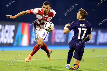 Croatia's Dejan Lovren (L) in action against France's Lucas Digne (R) during the UEFA Nations League soccer match between Croatia and France in Zagreb, Croatia, 14 October 2020.