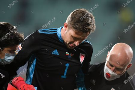 Wayne Hennessey goalkeeper of Wales (C) receives medical assistance after suffering an injury during the UEFA Nations League group stage, league B, group 4 match between Bulgaria and Wales in Sofia, Bulgaria  14 October 2020.