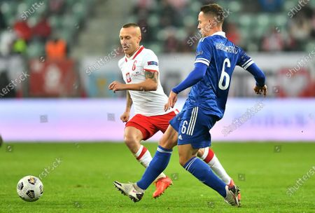 Jacek Goralski (L) of Poland and Amir Hadziahmetovic (R) of Bosnia and Herzegovina in action during the UEFA Nations League soccer match between Poland and Bosnia and Herzegovina in Wroclaw, western Poland, 14 October 2020.