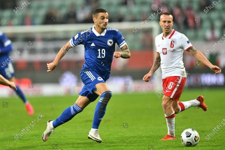 Jacek Goralski (R) of Poland and Rade Krunic (L) of Bosnia and Herzegovina in action during the UEFA Nations League soccer match between Poland and Bosnia and Herzegovina in Wroclaw, western Poland, 14 October 2020.