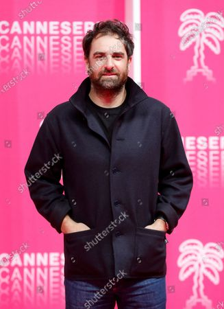 Gregory Montel poses on the pink carpet before the closing ceremony of the Cannes Series Festival, in Cannes, France, 14 October 2020.