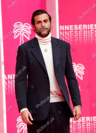 Canneseries jury member French actor Gregory Fitoussi poses on the pink carpet before the closing ceremony of the Cannes Series Festival, in Cannes, France, 14 October 2020.