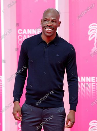 Canneseries jury member French actor Jean-Pascal Zadi poses on the pink carpet before the closing ceremony of the Cannes Series Festival, in Cannes, France, 14 October 2020.