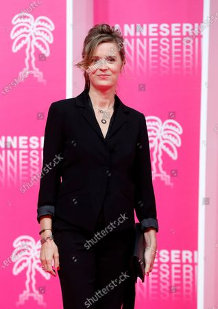 Canneseries jury member French actress Caroline Proust poses on the pink carpet before the closing ceremony of the Cannes Series Festival, in Cannes, France, 14 October 2020.