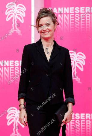 Stock Picture of Canneseries jury member French actress Caroline Proust poses on the pink carpet before the closing ceremony of the Cannes Series Festival, in Cannes, France, 14 October 2020.