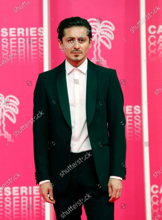Alexej Manvelov poses on the pink carpet before the closing ceremony of the Cannes Series Festival, in Cannes, France, 14 October 2020.