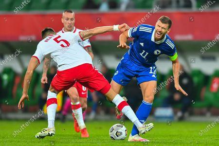 Jan Bednarek, Edin Dzeko during the UEFA Nations League group stage match between Poland and Bosnia-Herzegovina at Stadion Miejski