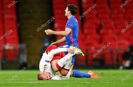 Denmark's Kasper Dolberg reacts after he was fouled by England's Harry Maguire during the UEFA Nations League soccer match between England and Denmark at Wembley Stadium in London, England