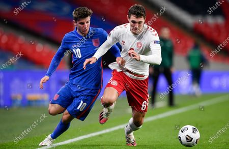 England's Mason Mount, left, and Denmark's Andreas Christensen battle for the ball during the UEFA Nations League soccer match between England and Denmark at Wembley Stadium in London, England