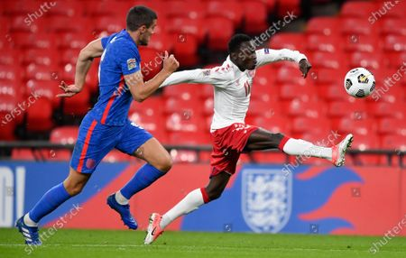 Denmark's Pione Sisto and England's Conor Coady, left, battle for the ball during the UEFA Nations League soccer match between England and Denmark at Wembley Stadium in London, England