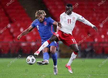 England's Reece James, left, and Denmark's Pione Sisto battle for the ball during the UEFA Nations League soccer match between England and Denmark at Wembley Stadium in London, England