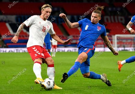 Denmark's Daniel Wass, left, and England's Kalvin Phillips battle for the ball during the UEFA Nations League soccer match between England and Denmark at Wembley Stadium in London, England