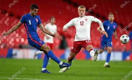 Denmark's Kasper Dolberg, right, attempts to block a kick from England's Conor Coady during the UEFA Nations League soccer match between England and Denmark at Wembley Stadium in London, England
