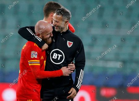 Wales' Jonny Williams celebrate his team's victory with his coach Ryan Giggs after the UEFA Nations League soccer match between Bulgaria and Wales at Vassil Levski national stadium in Sofia, Bulgaria