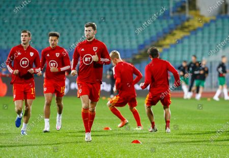 Wales captain Ben Davies, center, and his team mates warm up before UEFA Nations League soccer match between Bulgaria and Wales at Vassil Levski national stadium in Sofia, Bulgaria
