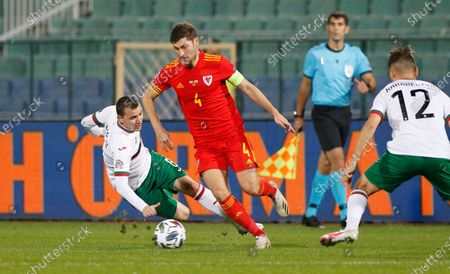 Bulgaria's Todor Nedelev, left, is challenged by Wales' Ben Davies during the UEFA Nations League soccer match between Bulgaria and Wales at Vassil Levski national stadium in Sofia, Bulgaria