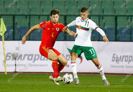 Bulgaria's Kiril Despodov, right, is challenged by Wales' Ben Davies during the UEFA Nations League soccer match between Bulgaria and Wales at Vassil Levski national stadium in Sofia, Bulgaria