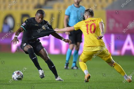 Austria's David Alaba, left, challenges for the ball with Romania's Alexandru Maxim during the UEFA Nations League soccer match between Romania and Austria at the Ilie Oana stadium in Ploiesti, Romania