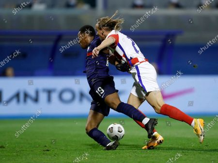 France's Anthony Martial, left, duels for the ball with Croatia's Domagoj Vida during the UEFA Nations League soccer match between Croatia and France at Maksimir Stadium in Zagreb, Croatia