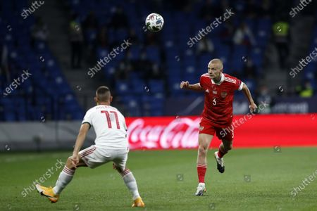 Russia's Igor Smolnikov, right, heads the ball as Hungary's Filip Holender defends during the UEFA Nations League soccer match between Russia and Hungary at Dinamo Stadium in Moscow, Russia