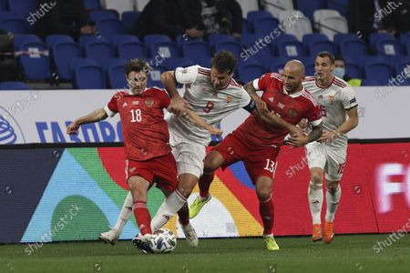 Russia's Yuri Zhirkov, left, and Fedor Kudryashov, right, try to stop Hungary's Adam Szalai during the UEFA Nations League soccer match between Russia and Hungary at Dinamo Stadium in Moscow, Russia