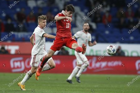 Russia's Igor Smolnikov takes a shot during the UEFA Nations League soccer match between Russia and Hungary at Dinamo Stadium in Moscow, Russia