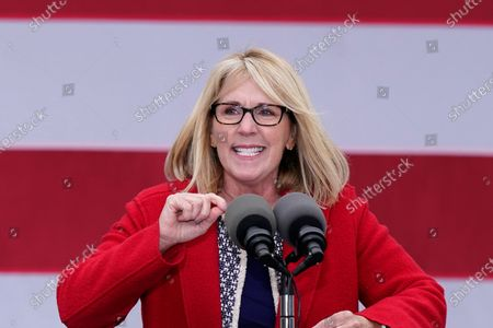 Stock Photo of Laura Cox, Chairwoman of the Michigan Republican Party, speaks before Vice President Mike Pence at a campaign rally, in Grand Rapids, Mich