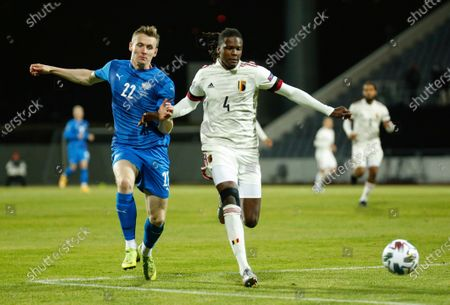 Belgium's Dedryck Boyata, right, is challenged by Iceland's Jon Dadi Bodvarsson, left, during the UEFA Nations League soccer match between Iceland and Belgium at the Laugardalsvollur stadium in Reykjavik, Iceland