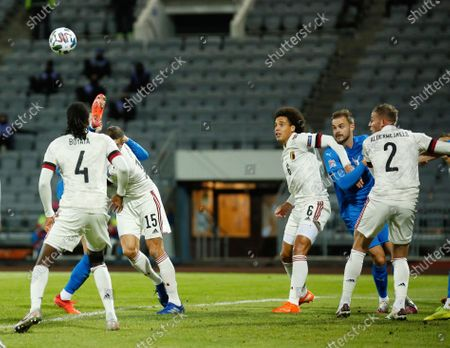 Iceland's Sverrir Ingi Ingason and Belgium's Dedryck Boyata, left, and Thomas Meunier, second to left, battle for the ball during the UEFA Nations League soccer match between Iceland and Belgium at the Laugardalsvollur stadium in Reykjavik, Iceland