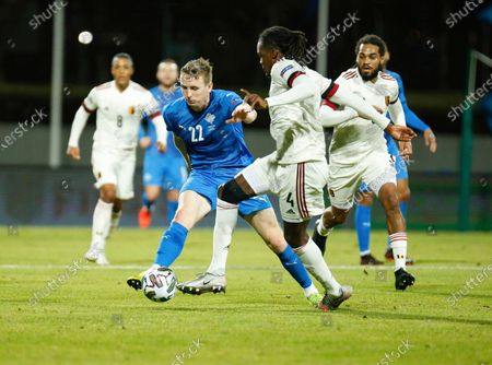Iceland's Jon Dadi Bodvarsson, left, challenges Belgium's Dedryck Boyata, right, during the UEFA Nations League soccer match between Iceland and Belgium at the Laugardalsvollur stadium in Reykjavik, Iceland