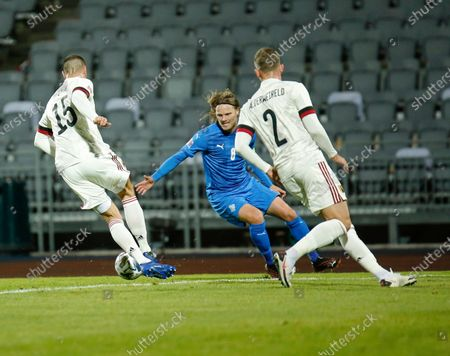 Belgium's Thomas Meunier, left, and Toby Alderweireld, right, are challenged by Iceland's Birkir Bjarnason, centre, during the UEFA Nations League soccer match between Iceland and Belgium at the Laugardalsvollur stadium in Reykjavik, Iceland