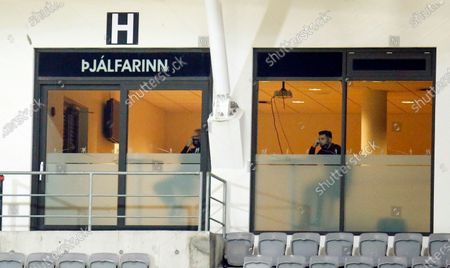 Iceland's coaches Erik Hamren, left, and Freyr Alexandersson, right, had to watch from a box since they were quarantined during the UEFA Nations League soccer match between Iceland and Belgium at the Laugardalsvollur stadium in Reykjavik, Iceland