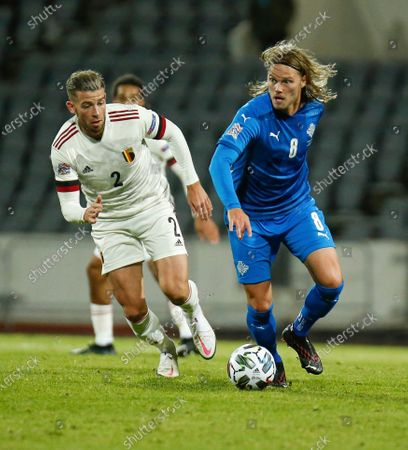 Iceland's Birkir Bjarnason, right, is challenged by Belgium's Toby Alderweireld, left, during the UEFA Nations League soccer match between Iceland and Belgium at the Laugardalsvollur stadium in Reykjavik, Iceland